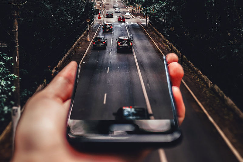 mobile phone morphing into road with cars
