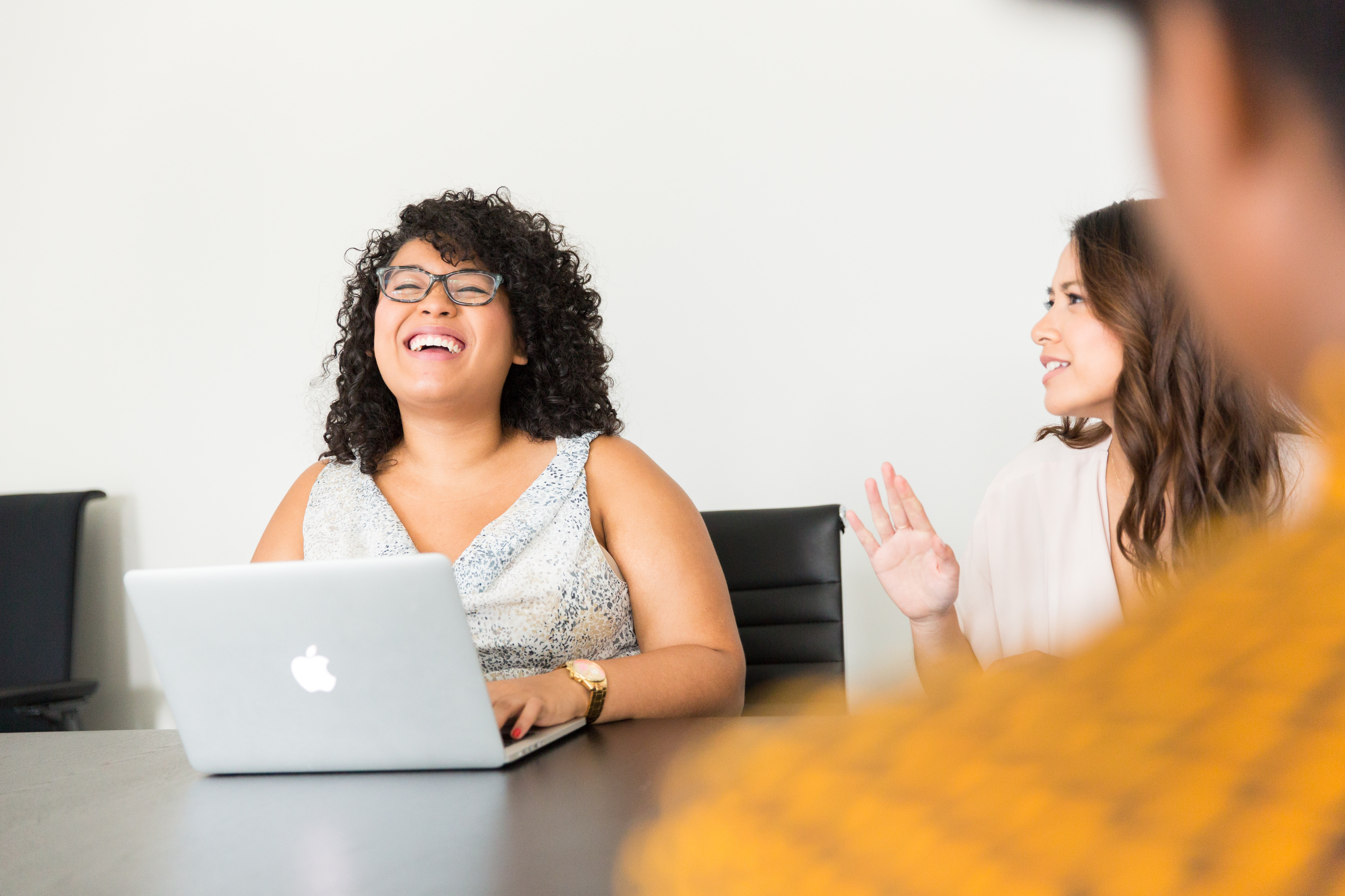 two women working and talking