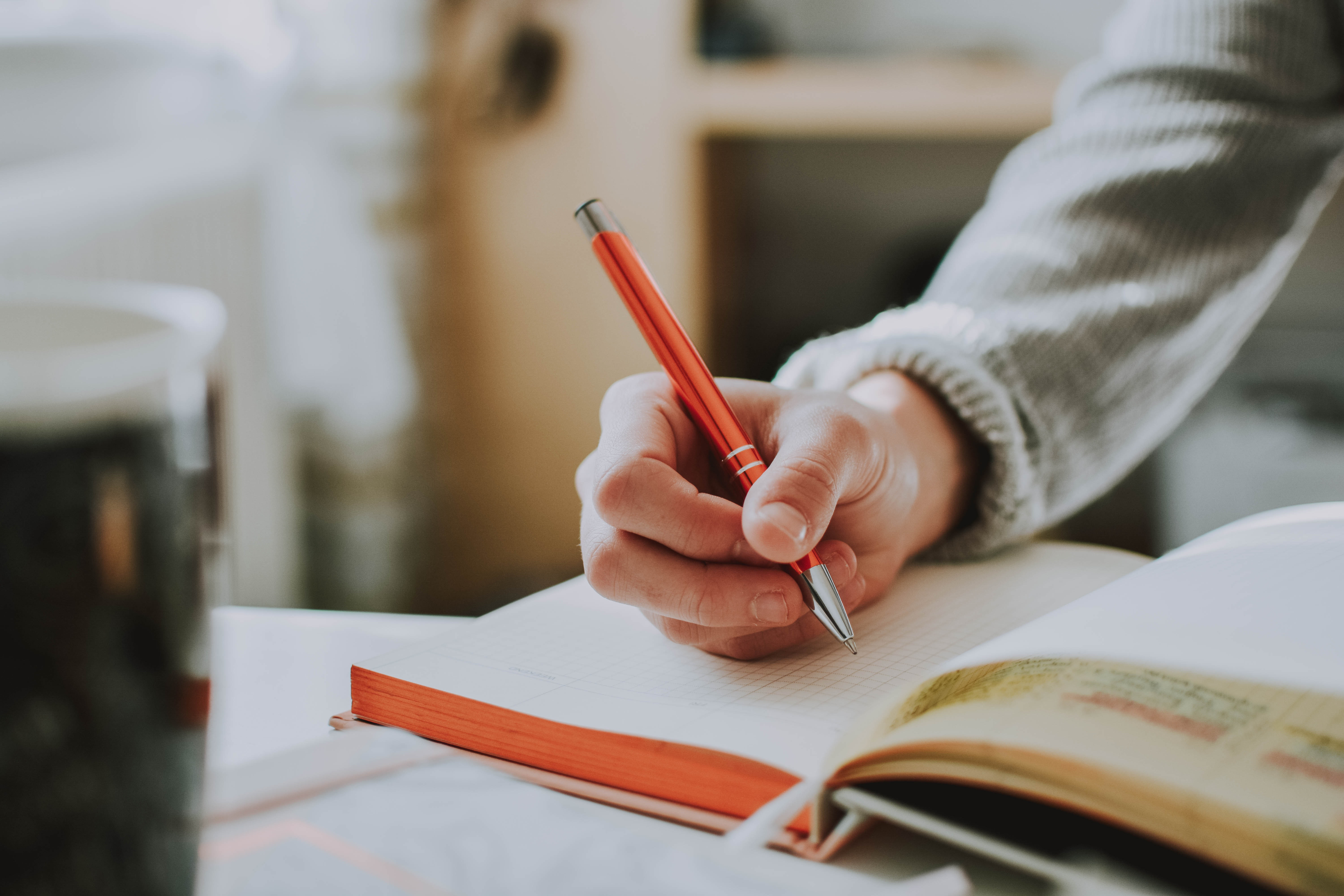 Hand writing in a notebook.