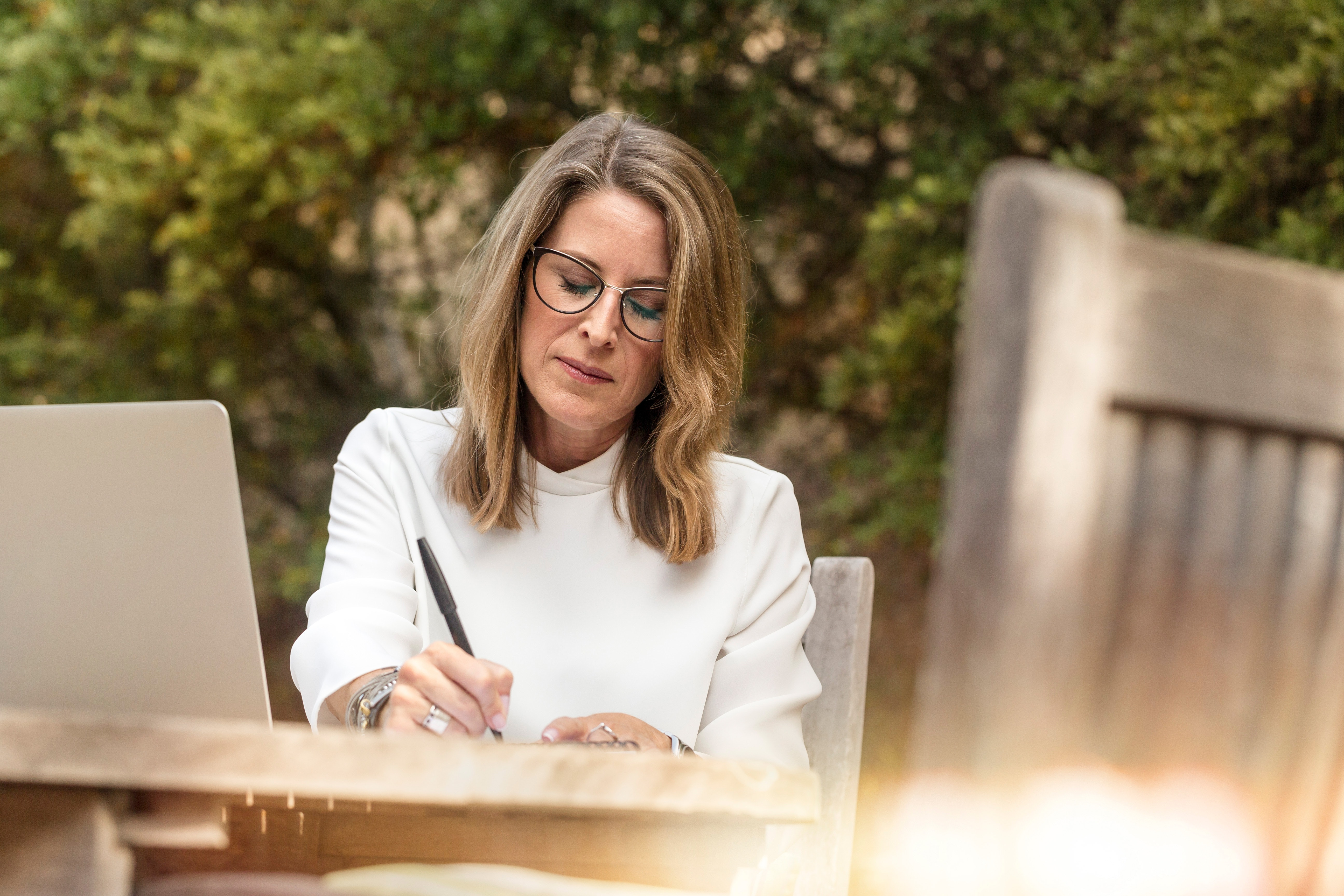 woman writing with semi-serious expression